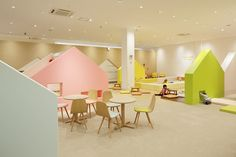 An Indoor Playground with Colourful Houses- Petit & Small