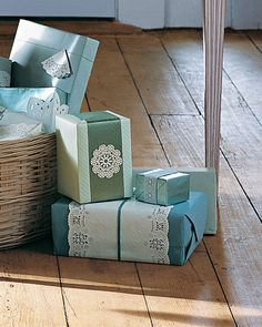 Doily Gift Wrap...  For an extra touch of whimsy, add Paper ( or actual )doilies to wrapped packages.