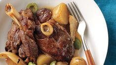 Lamb shanks are at their best when gently cooked. A slow cooker creates meltingly tender meat in a flavorful sauce -- perfect for Sunday dinner.