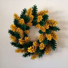 How to Make a Pine Cone Wreath: Today I am going to walk you through the steps of how to make a pine cone wreath. The wreath depicted (see pictures below) is sports-themed for a Green Bay Packer fan (not my favorite color scheme...