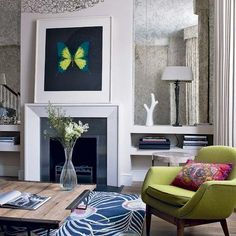 Antique mirror in alcoves + lamps + space for extra coffee table style books that don't fit on fitted shelving. Could then leave room above beam for a striking piece of art