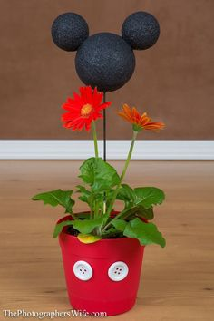 Mickey Flower Pot DIY Craft Disney -- too cute!  You could add photos instead of plants. Could use as a centerpiece for a party