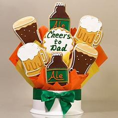 "7-Piece Cheers Cookie Bouquet - Beer glass, beer mug, ale bottle and ""Cheers to Dad"" hand-decorated cookies. Cookies are each approx. 4"" - 4.5"" tall."