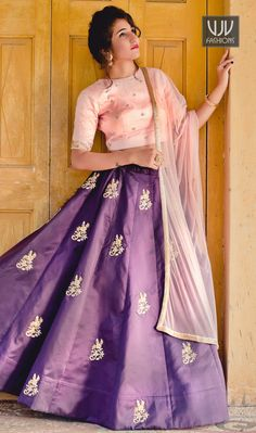 Phenomenal Purple Color Silk Designer Lehenga Choli Be an angel and create and ascertain a smashing impression on for every person by wearing this purple net a line lehenga choli. Beautified with embroidered and patch border work all synchronized well with the design and style of the attire