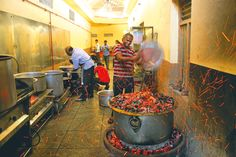 In Bengaluru's military hotels, meaty, hearty fare is cooked in large quantities, often over coals and served on plates and bowls made of dried leaves.