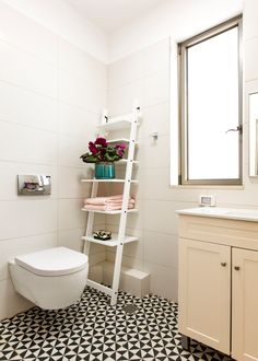 Adding a little drama with a black and white pattern floor to spice up your guest toilet