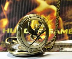 Hunger Games jewelry pocket watch necklace mocking bird pendant $3.51, via Etsy. LOVE!