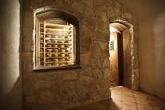 Cheese aging inside the underground cave - Picture of Brazos Valley Cheese, Waco - Tripadvisor Cheese Cave, Threshing Floor, Underground Caves, How To Make Cheese, Entry Doors, Entryway, Wine Cellar, Barn Wood, Candle Sconces