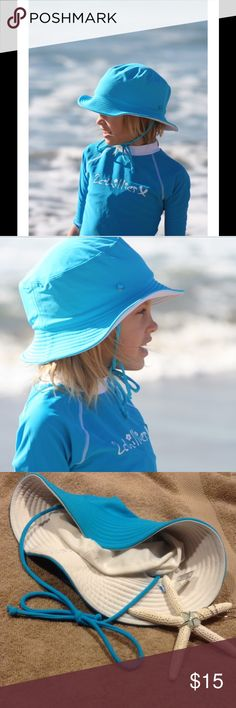 """Blue/White Reversible Sun Hat This adorable sun hat is reversible from white to blue. Features an optional neck tie. Water friendly nylon/elastane blend. Available in S/M( fits head circumference up to 18"""", and M/L( fits head circumference up to 19""""). 2Chillies Accessories Hats"""