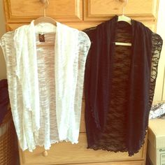 Bundle Light Sweaters Bundle of two very pretty light cover sweaters. Arm inserts. Black and white. One Size Fits Most. White has small hole under arm. Jackeez & Nicolz Sweaters