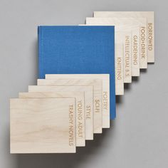 Set of 10 wood book dividers, $210. Over 100 panel options