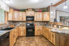 Commodore Homes of Pennsylvania Astro Ranch -  - 3A255A | Hickory Kitchen, spacious, great cabinet space, and countertop work space!