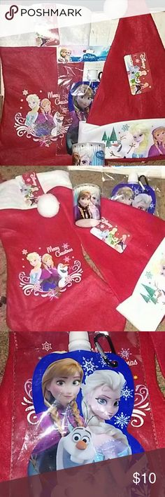 """NWT Christmas Stocking """"Frozen"""" Set New Christmas bundle for kids. Perfect stocking starter for the """"Frozen"""" fan or """"Elsa and Olaf"""" fan/lover!! Merry Christmas stocking with The Frozen characters in red with white cuff. And matching Santa hat!! Also included is a couple stocking stuffers to get you started...Frozen themed water bag/bottle with clip and a Frozen themed plastic container with qtips but once they are gone u have a cute lil container to keep whatever u would like!! Also a…"""