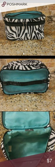 Cosmetic bag Zibra striped cosmetic bag medium size. Has a few marks but nothing to major Medela Bags Cosmetic Bags & Cases