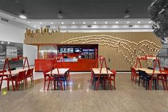 YOD Design Studio teamed up with graphic designer Ilya Nepravda, to create a fast food restaurant named WOKA, located in Poltava, Ukraine. Inspired by a bamboo forest with flickers of sunlight, ...