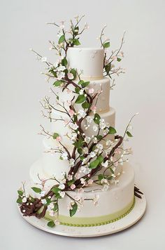 This rustic wedding cake from Ron Ben-Israel Cakes features twisting branches and tiny blooms, a fabulous choice for a garden wedding!