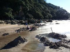 Visitors to New Zealand's Hot Water Beach Can Dig Their Own Geothermal Wading Pool
