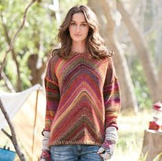 "SUNRISE SWEATER -- Space-dyed knit with chevroned stripes in front, drop shoulders and multicolored whip stitching all around. Each sweater is one-of-a-kind. Wool/acrylic. Hand wash. Imported. Exclusive. Sizes XS (2), S (4 to 6), M (8 to 10), L (12 to 14), XL (16). Approx. 25""L."
