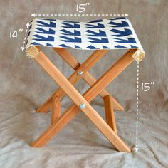 How to make a folding camp stool  This looks easy enough - good thing to use some of the greek key canvas on