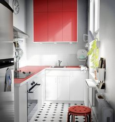 Two rows of Akurum Rubrik Applad red cabinets via Apartment Thereapy -10 Kitchen Ideas We Picked Up from IKEA's New 2015 Catalog