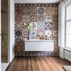 A guest bathroom in this home in Berlin, is totally transformed by these traditional earthy-hued tiles. The owner had been collecting them for many years and said the look she wanted was that of a kil Elle Decor, Bathroom Interior Design, Interior Decorating, Window In Shower, Bathroom Inspiration, Small Bathroom, Bathrooms, Bathroom Black, Master Bathroom