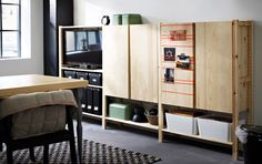 IVAR storage combination in 3 sections with shelves and cabinets in solid pine