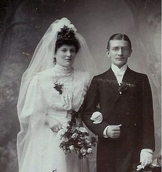 Lovely Wedding portrait 1900. A handsome couple. The bridal gown is typical of the period as is the groom's attire. He's wearing rimless hoopspring pince-nez eyeglasses clipped on the bridge of his nose..very stylish and extremely popular eyewear dur wedding dresses #weddingdress #weddingdresses See it here : http://www.amazon.com/gp/product/B002AVZ57K/ref=as_li_ss_tl?ie=UTF8=1789=390957=B002AVZ57K=as2=mantosuc-20