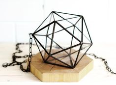 Meet our pendant Icosahedron minimalistic form for indoor succulent and air plants cultivation or wedding decor.  This neatly crafted pendant terrarium perfectly complement the style of the interior, and become a special piece for modern wedding photo session. #stereometricdesign #icosahedron #geometry #art #air #pendant #glasspot #glasbox #wedding #interioridea #retro #loftstyle #loft #hexagon #wood #interior #decor