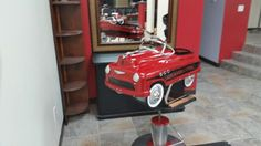 Pedal car barber chair is perfect for the special haircut.  Safety belt included.