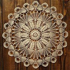 Beige crocheted doily. A wonderful decoration, original gift for friends and loved ones can be used as decor pillows, clothing, etc. Material: 100% mercerized cotton. Color: light beige . Max. size approx. 35cm (14 inches). Please note that due to the different color resolution of