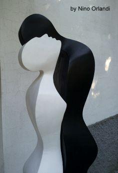 scultura in legno patinato