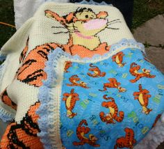 Tigger cross stitch on crochet blanket. Finished off with tigger backing.