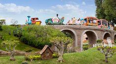 Casey Jr. Circus Train crosses a stone Storybook Land bridge