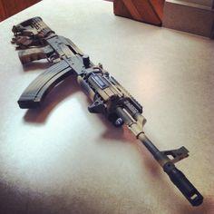 Norinco Mak90/AK-47, CAA Pistol Grip Tapco M4 Stock Adapter, Tapco AK74 Style Brake w/Thread Adapter, Insight M3X Light w/Pressure Switch, UTG Rail System, Beefy Charging Handle