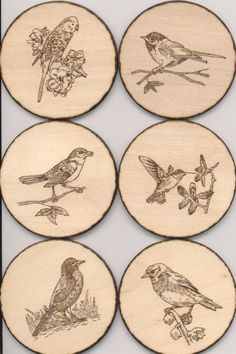 Birds that I woodburned onto wood circles.  I attached a magnet on the back, using Gorilla Glue.  After this picture was taken, I applied 2 coats of polyurethane.