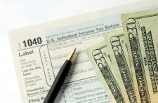 Tax return image via Shutterstock.