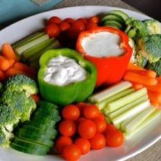 Awesome idea for a vegetable platter.  Hollow out peppers and fill with dip. by taren madsen