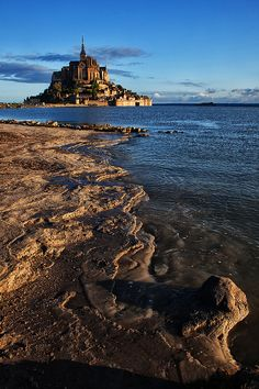 "Such a pretty view of the beach and the castle in the distance. ""Sunrise at Mont Saint-Michel, Normandy, France"""
