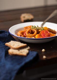 Squid with pasta in tomato sauce.