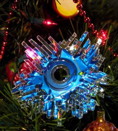 An ornament made from a CD run through a paper shredder? Not sure if this will really work, but it looks pretty neat in the picture. Maybe worth a try...
