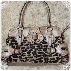 Leopard & Cream Guess Bag This has been one of my all time favorite bags. It has a lot of room inside with 2 open compartments and one zipper compartment in the middle. It has 2 pockets for cell phone, keys, etc, and one zipper pocket for Chapstick, pens, wallet, etc. Has been cleaned inside and out. ✅ Bundle and save on shipping! ✅ All reasonable offers are considered.  ✅ I always ship right away.  ❌ Trades ❌ Lowballing Guess Bags