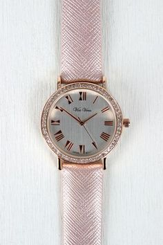 """Glitz And Glam Vegan Leather Watch    This watch features a vegan leather band, shimmer finish, cross hatch embossed detail, brushed metallic face, roman numerals, and rhinestones set in rim. Finished with an adjustable buckle closure.     Measures approx. 9.5"""" L x 1.5"""" W    https://www.shopwithbarkode.com/collections/modify-watches/products/ung73446"""