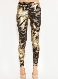 Black and Metallic Gold Zig Zag Print Leggings for only $16.10. Browse the UsTrendy catalog for the latest trends in indie fashion!