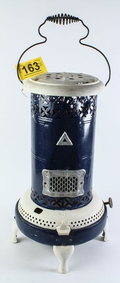 Lot 136 in the 8.5.14 online & live auction! A great rustic oil / kerosene heater made by Perfection Oil, Model No. 325. Great for camping or to use on your patio on those cool Arizona evenings! The footed heater has a wire bail handle and a navy blue chimney or stove pipe. The feet and top and bottom vents have been painted white. The chimney / stove pipe has a dent above the manufacturer's label. Working condition has not been determined. #Home #Decor #Furniture #POGAuctions