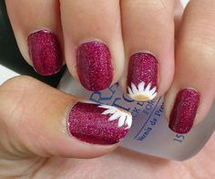 Upsie Daisy    If you want a distinctive motif on your nails, but don't think you can do a whole flower or other design, these artful daisy halves peeking up over the edges of nails are a fun and smart solution.