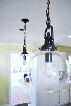 I Like Big Globes And I Cannot Lie | Young House Love. Clear glass globe pendant lights.