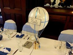 DIY Air Balloon Centerpieces for Travel-Themed Wedding -- table numbers where says Paris. I'm not even engaged, but travel is my theme for my future wedding, and this is perfect!