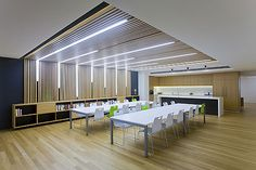 Love this vertical slat/ceiling with the fluorescent lights.