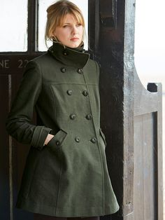 A luxuriously soft moleskin coat with a textured dotty design and classic double breasted fastening. This stylish coat nips in at the waist for a flattering fit and has two buttoned pockets.
