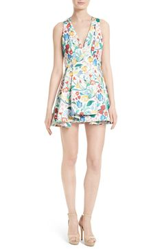 d1c3ea1b219 A colorful floral print charms this structured fit-and-flare dress